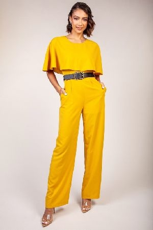 Soild mustard jumpsuit with a cape layer detail