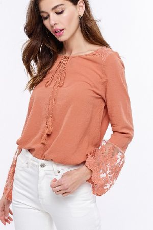 Textured solid peasant top with lace contrast