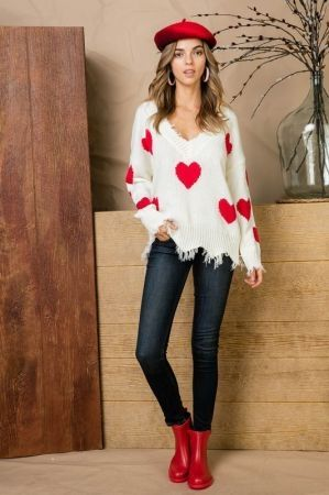 Red heart print distressed v neck sweater