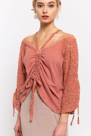 A lovely lace contrast top featuring lace fabrication on raglan sleeve