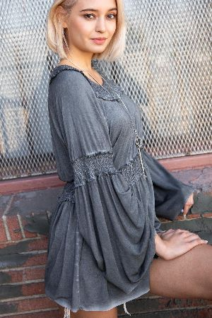 Flowy bell sleeves with smocking around waist
