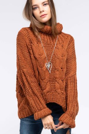 Hand made turtleneck cable knit sweater with asymetrical hemline