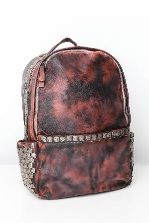 Metalic studded tie dye leather backpack