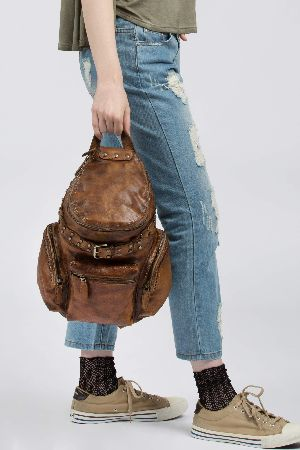 Vintage leather backpack with metal embellishment belt detail