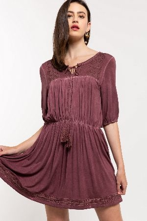 Embroidered shirred dress with tasseled front