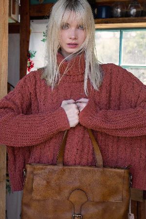 High low cable knit turtle neck sweater