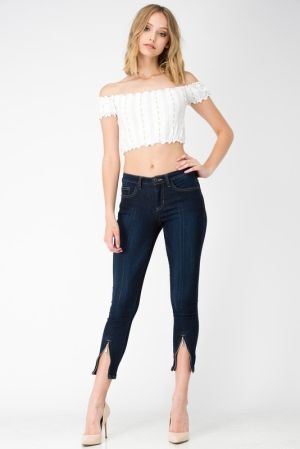 Mid rise skinny jeans with zipped front hem