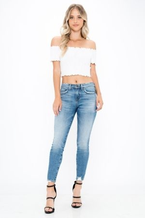 Slightly distressed high rise relaxed fit jeans